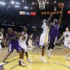 Photo - Sacramento Kings center DeMarcus Cousins (15) drives to the basket as Golden State Warriors center Jermaine O'Neal (7) defends during the first half of an NBA basketball game Friday, April 4, 2014, in Oakland, Calif. (AP Photo/Marcio Jose Sanchez)