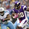 Photo -   Minnesota Vikings running back Adrian Peterson, right, runs from Tennessee Titans defensive tackle Jurrell Casey, left, during the first half of an NFL football game on Sunday, Oct. 7, 2012, in Minneapolis. (AP Photo/Genevieve Ross)