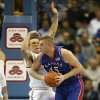 Kansas center Cole Aldrich (45) holds onto the ball while defended by UCLA forward Reeves Nelson in the second half of their NCAA college basketball game in Los Angeles on Sunday, Dec. 6, 2009. Kansas won 73-61. (AP Photo/Jason Redmond) ORG XMIT: CAJR110