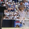 Photo - San Diego Padres' Everth Cabrera pops up from his slide at home plate umpire Gerry Davis points to the plate during a four-run rally against the Chicago Cubs in the sixth inning of a baseball game, Sunday, May 25, 2014, in San Diego. (AP Photo/Lenny Ignelzi)