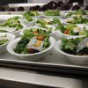 FILE - In this Sept. 12, 2012, file photo, side salads await the students of Eastside Elementary School in Clinton, Miss. The Agriculture Department is responding to criticism over new school lunch rules by allowing kids to eat more grains and meat in the lunchroom. Agriculture Secretary Tom Vilsack said in a letter to members of Congress Friday, Dec. 7, 2012, that the department will do away with daily and weekly maximums of meats and grains. Several members of Congress have written the department since the new rules went into effect in September saying kids aren't getting enough to eat. School administrators have also complained, saying that set maximums on grains and meats are too limiting as they try to plan daily meals.