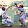 Photo -   Baltimore Orioles' Chris Davis, left, begins his slide into home plate to score on a double by Adam Jones as Los Angeles Angels catcher Bobby Wilson, right, reaches for the ball during the first inning of a baseball game on Wednesday, June 27, 2012, in Baltimore. (AP Photo/Nick Wass)