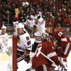 Chicago Blackhawks\' Bryan Bickell (29) celebrates goal by teammate Viktor Stalberg (25), of Sweden, as Phoenix Coyotes\' Mike Smith (41) and Michael Stone (29) look on during the first period in an NHL hockey game Thursday, Feb. 7, 2013, in Glendale, Ariz.(AP Photo/Ross D. Franklin)