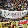 Photo - ADDS TRANSLATION OF THE BANNER IN CENTER - Protesters march during an anti-nuclear demonstration in Taipei, Taiwan, Saturday, March 9, 2013. Tens of thousands of Taiwanese have protested to demand that the government scrap a $10 billion nuclear power plant that is nearly complete and slated to begin operating in two years. The white banner reads: