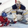 Montreal Canadiens\' Travis Moen (32) slides in on Buffalo Sabres\' goaltender Ryan Miller during the second period of an NHL hockey game in Montreal, Saturday ,Feb. 2, 2013. (AP Photo/The Canadian Press, Graham Hughes)