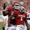 OU\'s Tony Jefferson (1) and David King (90) celebrate during the Red River Rivalry college football game between the University of Oklahoma (OU) and the University of Texas (UT) at the Cotton Bowl in Dallas, Saturday, Oct. 13, 2012. Oklahoma won 63-21. Photo by Bryan Terry, The Oklahoman
