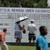 Fans walk past a leader board during a practice round for the U.S. Senior Open at Oak Tree National in Edmond, Okla., Tuesday, July 8, 2014. Photo by Bryan Terry, The Oklahoman