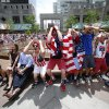 United States fans react while watching the final minutes of the 2014 World Cup soccer match between the United States and Germany at a public viewing party, Thursday, June 26, 2014, in Philadelphia. Germany defeated the United States 1-0 to win Group G ahead of the Americans, who also advanced to the knockout stage of the World Cup despite losing. (AP Photo/Matt Rourke)