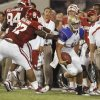 Oklahoma\'s Jamarkus McFarland (97) pushes Tulas quarterback G.J. Kinne our of bounds during the second half of the college football game between the University of Oklahoma Sooners ( OU) and the Tulsa University Hurricanes (TU) at the Gaylord Family-Memorial Stadium on Saturday, Sept. 3, 2011, in Norman, Okla. Photo by Steve Sisney, The Oklahoman ORG XMIT: KOD