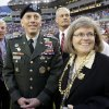 FILE - In this Feb. 1, 2009 file photo, Gen. David Petraeus, commander U.S. Central Command, left, stands with his wife Holly before the NFL Super Bowl XLIII football game between the Arizona Cardinals and the Pittsburgh Steelers in Tampa, Fla. Gen. Petraeus, the retired four-star general who led the U.S. military campaigns in Iraq and Afghanistan, resigned Friday, Nov. 9, 2012 as director of the CIA after admitting he had an extramarital affair. (AP Photo/David J. Phillip, File)