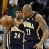 Indiana Pacers forward David West, front, slams the ball on the court as forward Paul George looks on after the Denver Nuggets\' 102-101 victory over the Pacers in an NBA basketball game in Denver on Monday, Jan. 28, 2013. George fouled Nuggets guard Andre Iguodala with four-tenths of a second remaining in the game to send Iguodala to the free throw line for the winning score. (AP Photo/David Zalubowski)