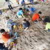 Children play in a large sand pile during school day of the Oklahoma Wildlife Expo at the Lazy E Arena and Ranch in Guthrie, OK, Friday, September 28, 2012, By Paul Hellstern, The Oklahoman