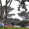 Photo - Suzann Pettersen, center, of Norway hits from the third tee of the Lake Merced Golf Club during the first round of the Swinging Skirts LPGA Classic golf tournament on Thursday, April 24, 2014, in Daly City, Calif. (AP Photo/Eric Risberg)