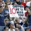 Photo -   Atlanta Braves fans hold a sign during the fourth inning of the National League wild card playoff baseball game between the Braves and the St. Louis Cardinals, Friday, Oct. 5, 2012, in Atlanta. (AP Photo/John Bazemore)