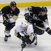 Pittsburgh Penguins\' White Team\'s Evgeni Malkin (71) collides with Penguin\'s Black Team\'s Craig Adams (27) and Robert Bortuzzo (41) during the first period of an NHL hockey scrimmage in Pittsburgh, Wednesday, Jan. 16, 2013. (AP Photo/Gene J. Puskar)