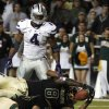 Baylor running back Glasco Martin (8) scores a touchdown over teammate offensive linesman Troy Baker (75) as Kansas State linebacker Arthur Brown (4) watches during the first half of an NCAA college football game Saturday, Nov. 17, 2012, in Waco, Texas. (AP Photo/LM Otero)