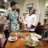 FILE - In this Sept. 15, 2011 file photo, first lady Michelle Obama, accompanied by Darden chef Julie Elkinton, second from right, talk to Charisse McElroy, right, and her daughter Jacqueline McElroy, 9, during a Let's Move! event in one of Darden's national restaurants in Hyattsville, Md. Recent changes put in place by the food industry are in response to the campaign against childhood obesity that Obama began waging three years ago. (AP Photo/Manuel Balce Ceneta, File)