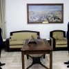Photo - In this photo released by the Syrian official news agency SANA, Ahmed Sheikh Abdul Qadir, left, is sworn in as governor of Latakia province, by Syrian President Bashar Assad, right, in Damascus, Syria, Sunday, June 2, 2013. (AP Photo/SANA)