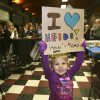Four-year-old Maya Lahlum holds up a sign supporting Democratic U.S. Senate candidate Heidi Heitkamp as she speaks during a campaign stop at Teamsters Hall in Fargo, N.D, Monday, Nov. 5, 2012. Heitkamp is running against Republican Rick Berg for the North Dakota\'s U.S Senate seat. (AP Photo/LM Otero)