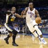 Oklahoma City \'s Serge Ibaka (9) drives past Utah\'s Jeremy Evans (40) during the NBA game between the Oklahoma City Thunder and the Utah Jazz at the Chesapeake Energy Arena, Sunday, March 30, 2014, in Oklahoma City. Photo by Sarah Phipps, The Oklahoman