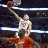 Oklahoma\'s Austin Johnson (20) drives to the basket past Syracuse\'s Rick Jackson (00) during the second half of the NCAA Men\'s Basketball Regional at the FedEx Forum on Friday, March 27, 2009, in Memphis, Tenn. PHOTO BY CHRIS LANDSBERGER, THE OKLAHOMAN