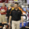 Oklahoma State head coach Mike Gundy watches his players warm up prior to the Fiesta Bowl NCAA college football game against Stanford Monday, Jan. 2, 2012, in Glendale, Ariz.(AP Photo/Ross D. Franklin)