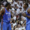 Oklahoma City Thunder center Kendrick Perkins (5) and power forward Serge Ibaka (9) from Republic of Congo have a talk between plays against the Oklahoma City Thunder during the first half at Game 3 of the NBA finals basketball series, Sunday, June 17, 2012, in Miami. (AP Photo/Lynne Sladky)