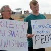 Chuck Skoro, left, and Greg Franz, both of Boise, Idaho, join a small group of protesters outside the Idaho Department of Corrections in opposition to the scheduled execution of Richard Leavitt on Tuesday, June 12, 2012 in Kuna. Prison officials declared Leavitt, 53, dead at 10:25 a.m. Tuesday by lethal injection at the Idaho Maximum Security Institution. It was only Idaho's second execution in 17 years. Leavitt was convicted of stabbing 31-year-old Danette Elg, of Blackfoot, in 1984. Leavitt\'s execution marked the first time witnesses had full viewing access to a convicted killer\'s lethal injection after the 9th U.S. Circuit Court of Appeals a few days before the execution sided with The Associated Press and other news organizations seeking full viewing access to a convicted killer\'s lethal injection. (AP Photo/Idaho Press-Tribune, Greg Kreller) MANDATORY CREDIT