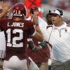 Head coach Bob Stoops gives high fives to quarterback Landry Jones after a touchdown against Idaho State during the first half of the college football game between The University of Oklahoma Sooners (OU) and Idaho State University Bengals (ISU) at the Gaylord Family -- Oklahoma Memorial Stadium on Saturday, Sept. 12, 2009, in Norman, Okla. Photo by Chris Landsberger, The Oklahoman. ORG XMIT: KOD