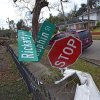 A street sign is bent at a severe angle from a Christmas Day tornado as residents clean up and assess the damage Wednesday, Dec. 26, 2012 in Mobile, Ala. With only a handful of injuries and no deaths reported statewide from the storms, the head of the state\'s emergency response said it was difficult to fathom how the toll wasn\'t worse. (AP Photo/G.M. Andrews)
