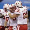 Nebraska quarterback Taylor Martinez (3) celebrates with Ben Cotton after Martinez ran 76 yards for a touchdown during the first half of the Big Ten championship NCAA college football game against Wisconsin on Saturday, Dec. 1, 2012, in Indianapolis. (AP Photo/Michael Conroy)
