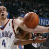 Oklahoma City\'s Nick Collison (4) grabs a rebound during the NBA basketball game between the Oklahoma City Thunder and Philadelphia at the Ford Center, Sunday, March 8, 2009, in Oklahoma City . PHOTO BY SARAH PHIPPS, THE OKLAHOMAN ORG XMIT: KOD