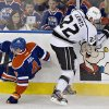 Los Angeles Kings\' Trevor Lewis, right, checks Edmonton Oilers\' Taylor Hall during second period NHL hockey action in Edmonton, Alberta, on Tuesday Feb. 19, 2013. (AP Photo/THE CANADIAN PRESS,Jason Franson)