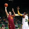 Iowa State\'s Georges Niang (31) shoots past Baylor\'s Cory Jefferson (34) and Isaiah Austin (21) in the first half of an NCAA college basketball game, Wednesday, Feb. 20, 2013, in Waco, Texas. (AP Photo/The Waco Tribune-Herald, Michael Bancale)