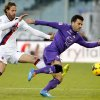 Photo - In this Dec. 15, 2013, file photo, Fiorentina's Giuseppe Rossi dribbles past Bologna's Cesare Natali  during a Serie A soccer match at Artemio Franchi stadium in Florence, Italy. Rossi and Antonio Cassano were called up for World Cup fitness tests Friday, April 11, 2014, by Italy coach Cesare Prandelli. Rossi was Serie A's top scorer until he re-injured his problematic right knee in January and has only recently begun training again. (AP Photo/Fabrizio Giovannozzi, File)
