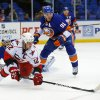 Photo - Carolina Hurricanes center Eric Staal (12) passes the puck out to a teammate in front of New York Islanders center John Tavares (91) during the first period of an NHL hockey game at the Nassau Coliseum in Uniondale, N.Y., Monday, Feb.11, 2013. (AP Photo/Paul J. Bereswill)