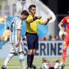 Photo - Argentina's Lucas Biglia (6) checks on his teammate Angel di Maria while referee Nicola Rizzoli from Italy calls for a stretcher during the World Cup quarterfinal soccer match between Argentina and Belgium at the Estadio Nacional in Brasilia, Brazil, Saturday, July 5, 2014. (AP Photo/Victor R. Caivano)