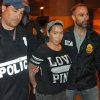 Photo - In this Monday, June 9, 2014 photo provided by the Drug Enforcement Administration, Samantha Barbash, center, is escorted by law enforcement officers following her arrest in New York. Barbash is allegedly part of a crew of New York City strippers who scammed wealthy men by drugging them and running up extravagant bills at topless clubs while they were in a daze, according to authorities. (AP Photo/DEA)