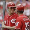 Cincinnati Reds\' Homer Bailey. left, talks with third base coach Chris Speier (35) in the fifth inning of a baseball game against the Pittsburgh Pirates, Sunday, July 21, 2013, in Cincinnati. Bailey hit a sacrifice bunt in the at-bat. (AP Photo/Al Behrman)