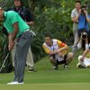 Photo - Chinese fans watch Tiger Woods of the U.S. play during an exhibition golf match against Rory Mcllory of Northern Ireland in Haikou, in southern China's island province Hainan, Monday, Oct. 28, 2013. Mcllory won the match, finishing on 6-under 73. (AP Photo/Vincent Yu)