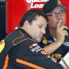 Photo - Driver Tony Stewart, left, talks with his crew chief Steve Addington during a break in practice for the NASCAR Sprint cup series Quaker State 400 at the Kentucky Speedway in Sparta, Ky., Friday, June 28, 2013. (AP Photo/James Crisp)
