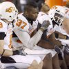 OSU\'s Brandon Pettigrew, center, and Dez Bryant, right, sit on the bench during the final seconds of their loss in the Holiday Bowl college football between Oklahoma State and Oregon at Qualcomm Stadium in San Diego, Tuesday, Dec. 30, 2008. PHOTO BY BRYAN TERRY, THE OKLAHOMAN.