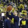 Michigan forward Mitch McGary (4) practices his free throws before the first half of an NCAA college basketball game against Arizona in Ann Arbor, Mich., Saturday, Dec. 14, 2013. (AP Photo/Carlos Osorio)