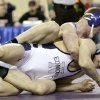 Sapulpa\'s Caleb Carter wrestles Edmond North\'s Andrew Dixon in the 195-pound match during the state wrestling championships at the State Fair Arena in Oklahoma City, Saturday, Feb. 25, 2012. Photo by Sarah Phipps, The Oklahoman
