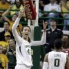 Baylor\'s Brittney Griner (42) reacts after she blocked a shot against Oklahoma\'s Aaryn Ellenberg during the second half of a NCAA college basketball game Saturday, Jan. 26, 2013, in Waco Texas. It was Griners\' 665th career blocked shot, surpassing the NCAA women\'s record set by Louella Tomlinson for St. Mary\'s in California from 2007-11. Baylor won 82-65. (AP Photo/LM Otero) ORG XMIT: TXMO111