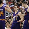 Photo - Phoenix Suns' Goran Dragic, center, of Slovenia, is greeted by Gerald Green, left, and Miles Plumlee after making a basket during the first half of an NBA basketball game against the Los Angeles Clippers on Monday, Dec. 30, 2013, in Los Angeles. (AP Photo/Jae C. Hong)