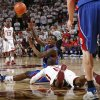 KU\'s Tyshawn Taylor (15) tosses the ball to another Jayhawk over OU\'s Tony Crocker (5) in the second half of the men\'s college basketball game between Kansas and Oklahoma at the Lloyd Noble Center in Norman, Okla., Monday, February 23, 2009. KU won, 87-78. BY NATE BILLINGS, THE OKLAHOMAN