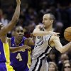 Photo - San Antonio Spurs' Manu Ginobili, right, of Argentina, is pressured by Los Angeles Lakers' Jodie Meeks (20) and Antawn Jamison (4) during the first half of Game 1 of their first-round NBA playoff basketball series, Sunday, April 21, 2013, in San Antonio. (AP Photo/Eric Gay)
