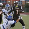 Putnam City\'s Gerrell Murry fights off Sapulpa\'s Jacob Shanahan (13) and Malik Swift during their high school football game at Putnam City in Oklahoma City, Thursday, Sept. 26, 2013. Photo by Bryan Terry, The Oklahoman