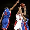 John Marshall\'s Rolando Gardner (4) and Quinn Huddleston (30) try to block Rotnei Clarke\'s (15) shot during the Class 3A semifinal on Friday, March 7, 2008, at the State Fair Arena in Oklahoma City, Okla. BY SARAH PHIPPS, THE OKLAHOMAN